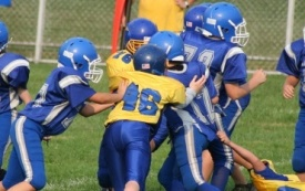 Break down youth football players into small groups in practice to develop chemistry